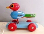 1950's bird painted wooden pull toy ... bright cheery bouncy bird