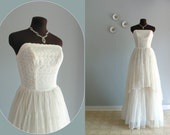 reserved... a 1950s Wedding Dress / 50s vintage strapless Eyelet Lace Chiffon Gown ... 23.5 waist