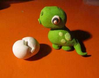 Baby dinosaur cake topper