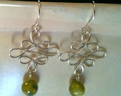 Celtic wire earrings with green shell beads