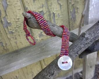 WOVEN bracelet in red tones