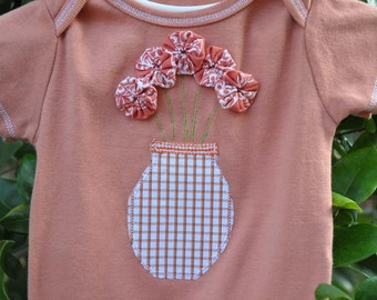 Hand dyed terra cotta color 9 month size onesie embellished with vase of flowers for a baby girl