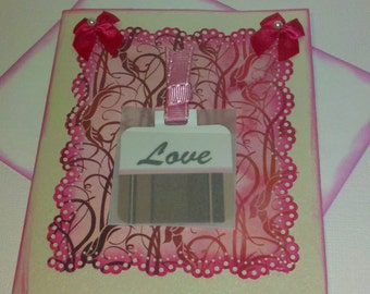 Love all occasion greeting card with a writable tag in vellum envelope.