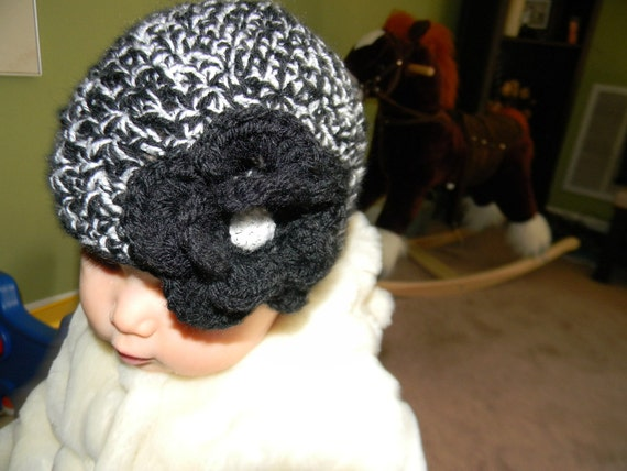 Baby girl  beanie mix of black and silver with  a big flower