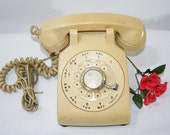 SALE ....Vintage Beige Rotary Dial Telephone, beige or buttery yellow depending on the light