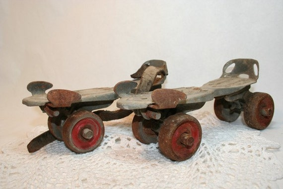 Metal Roller Skates with Red Wheels that attached to your Ked's