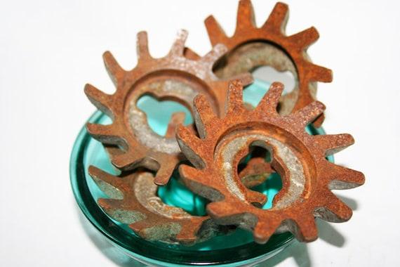 Industrial Metal Gears in Flower Pinwheel shapes, rusty