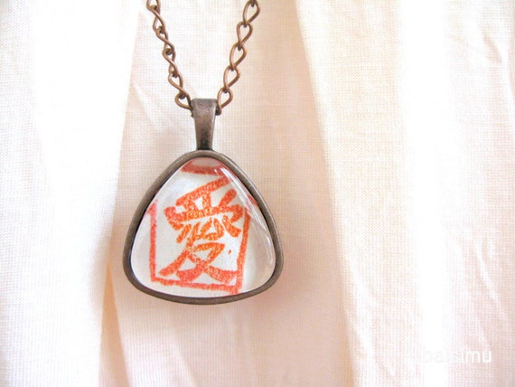 Love. Triangular copper necklace handprinted in red
