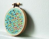 Island Getaway. Hand Embroidery in 3 inch Hoop. Wishbone Stitch Circle. Mint, Blue, Pink. By merriweathercouncil on Etsy