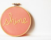 Hand Embroidered Hoop Sign. Shine. Text hand Stitched in Yellow on Salmon Fabric. Handmade by merriweathercouncil on Etsy