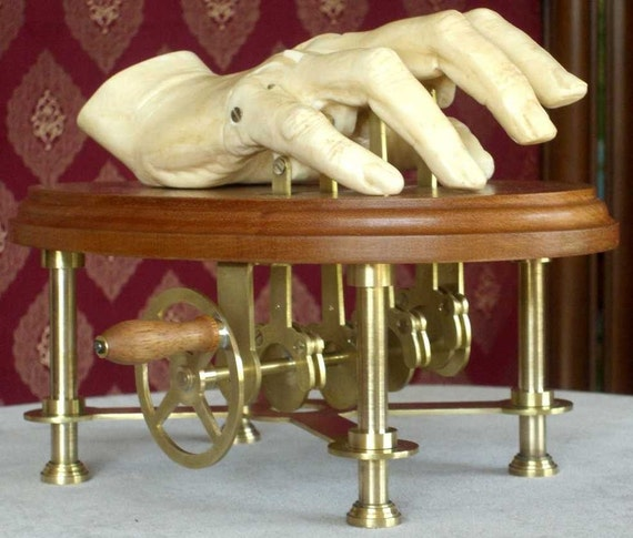 Hand operated automaton sculpture