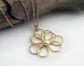 Gold Circular Petals Necklace with a white pearl