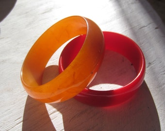 "1940s Bakelite bracelets Candy Apple and Orange Swirl 1"" wide"