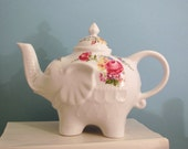 Shabby chic elephant teapot with rose, yellow, and blue flowers