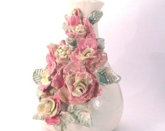 Vase with handmade flowers of pink and yellow