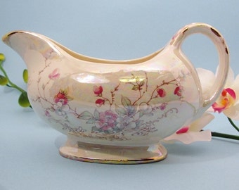 Gravy boat with pink Belle Francais blossom design with luster overglaze and 22 kt gold