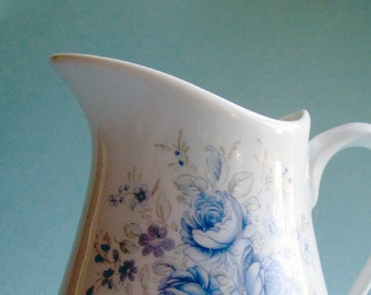 Blue and white farmhouse style pitcher with a pretty blue roses design
