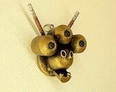 Gornash the Destroyer 3 Eyes Alien Head Wood Scifi Pendant Ornament Dangle