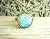 Japanese Chiyogami Paper Vintage Ring Resin finished like Glass, Adjustable Handmade Exclusive Design Image  - Antique Bronze Co Light blue cherry blossoms