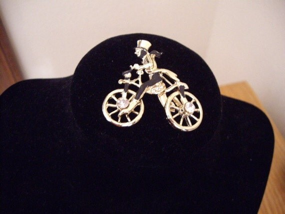 Man riding a bike vintage brooch