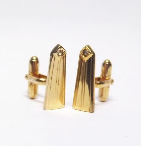 Anson gold tone cuff links with rhinestone like washington monument