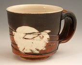 Brown and black ceramic bunny carrot mug with sgraffito illustration, pottery