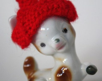 small deer with red hat