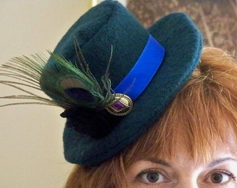 Timing is Everything ... teal blue mini top hat fascinator with peacock feather