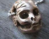 Fractured barbie skull bronze sculpture