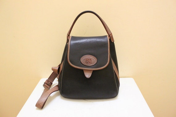Dooney and Bourke Black and Tan Color Leather Back pack.