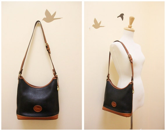 Dooney and Bourke Navy Pebble leather with tan color leather trim shoulder bag