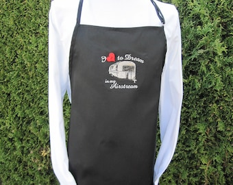 Apron with exclusive airstream logo and a heart button. Be the first to strut the campground in this cute number.
