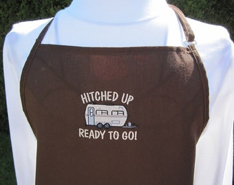 Three pocket Apron with a trailer embroidery comes in brown or green let me know your color choice