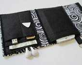Nerd Herder gadget wallet in Twirl for iPod, Android, iPhone, camera, earbuds, SD cards, USB, extra batteries, guitar picks,