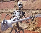 Zombie Skeleton Playing Electric Bass Guitar Metal Sculpture