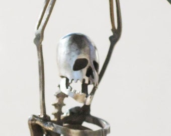 Zombie Skeleton Hanging On for Life Metal Sculpture