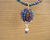 Irridescent/ peacock beaded necklace with dangle