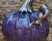 Hand blown glass pumpkin iridized orange with blue and a golden stem