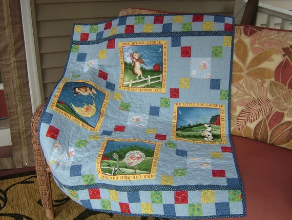Crib size Quilt featuring a Nursery Rhyme theme in light blue and other primary colors