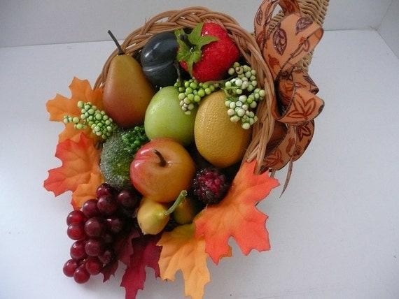 Thanksgiving wicker and fruit cornucopia centerpiece