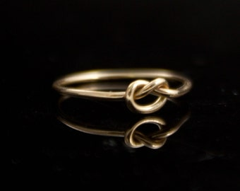 14K Gold Love knot ring - Solid 14 Karat gold infinity ring. Promise ring. Simple purity ring. Committment Forget me knot