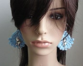 Crochet Earrings in mix blue acrylic yarn with dolphins charms