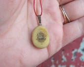 vintage c. 1950s scrimshaw pendant on red waxed linen thread // clipper ship
