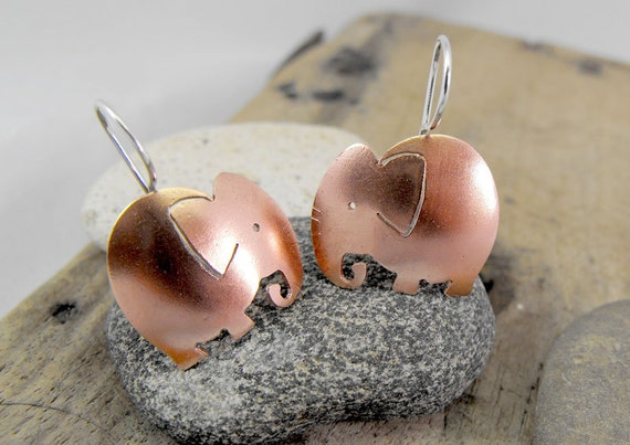 Cute elephant earrings in copper with sterling silver hooks. Handmade with love