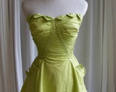 1950's CATALINA green strapless swimsuit. Skirt, ruching, pockets, boned, triangle trim. Pin Up, Burlesque, Rockabilly Xmas resort.