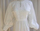 1960s Boho Dress Vintage white cotton. Long, intricate embroidery, puffed billowed sleeves, pleating. Bohemian Spring Wedding.