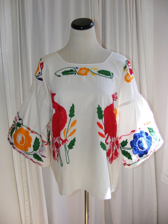Mexican Peacock Blouse. Hand Embroidered Multicolored bird and floral white Cotton Vintage top with wide bell sleeves.