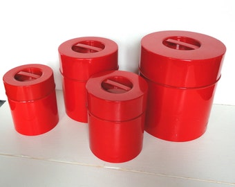 Vintage Red Metal Canister Set of Four