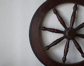 o captain, my captain. vintage wooden ship wheel