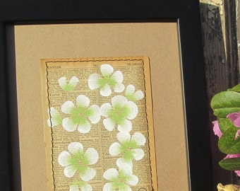 Tea... recycled book art Fresh Green Blossoms painted on an Antique 1930s Encyclopedia book page Stitched to cardstock